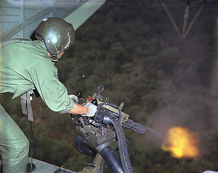 A USAF helicopter crewman fires a M134 during a patrol over Vietnam in 1968. Photo by USAF SSgt Paul Hagerty.