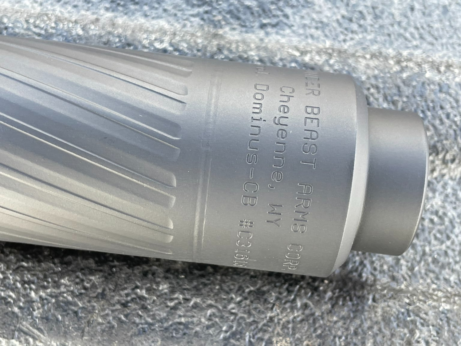 Once an affected suppressor has been fixed, you'll be able to tell by the visible seam shown here, between the engraved lettering and the fluting. This seam won't be seen on unrepaired cans.