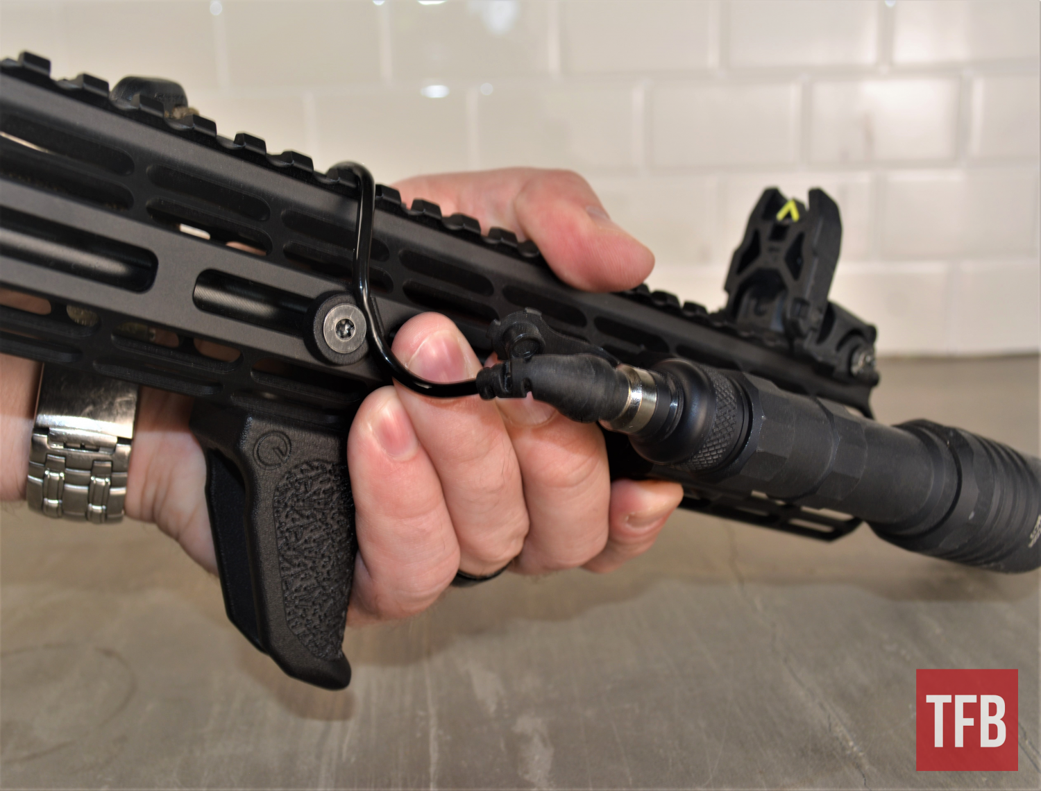 One of Emissary Development's Micro Cable Clips and Handbrakes on my tester rifle for hands-on evaluation.