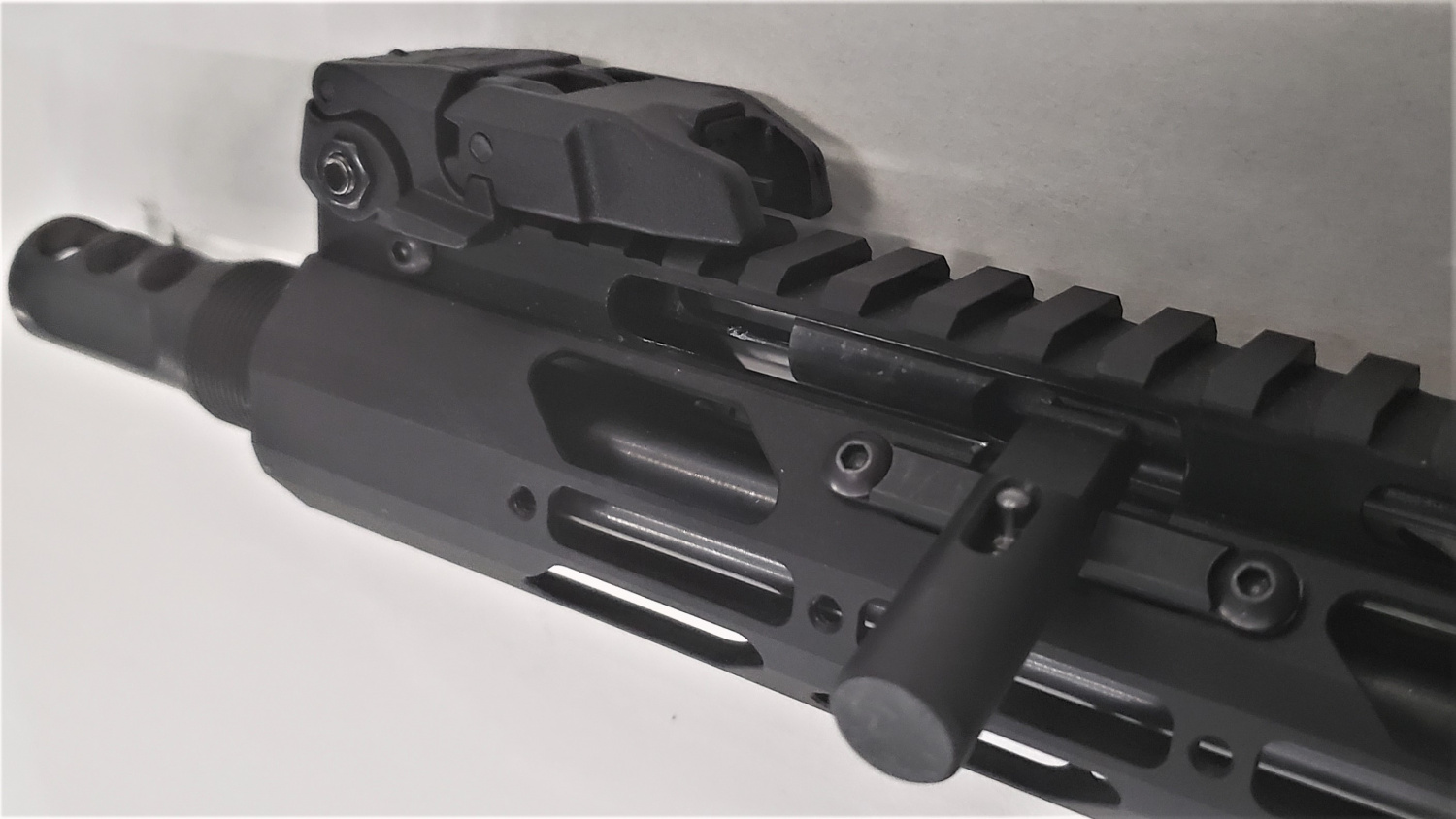Charging handle in the rearward position