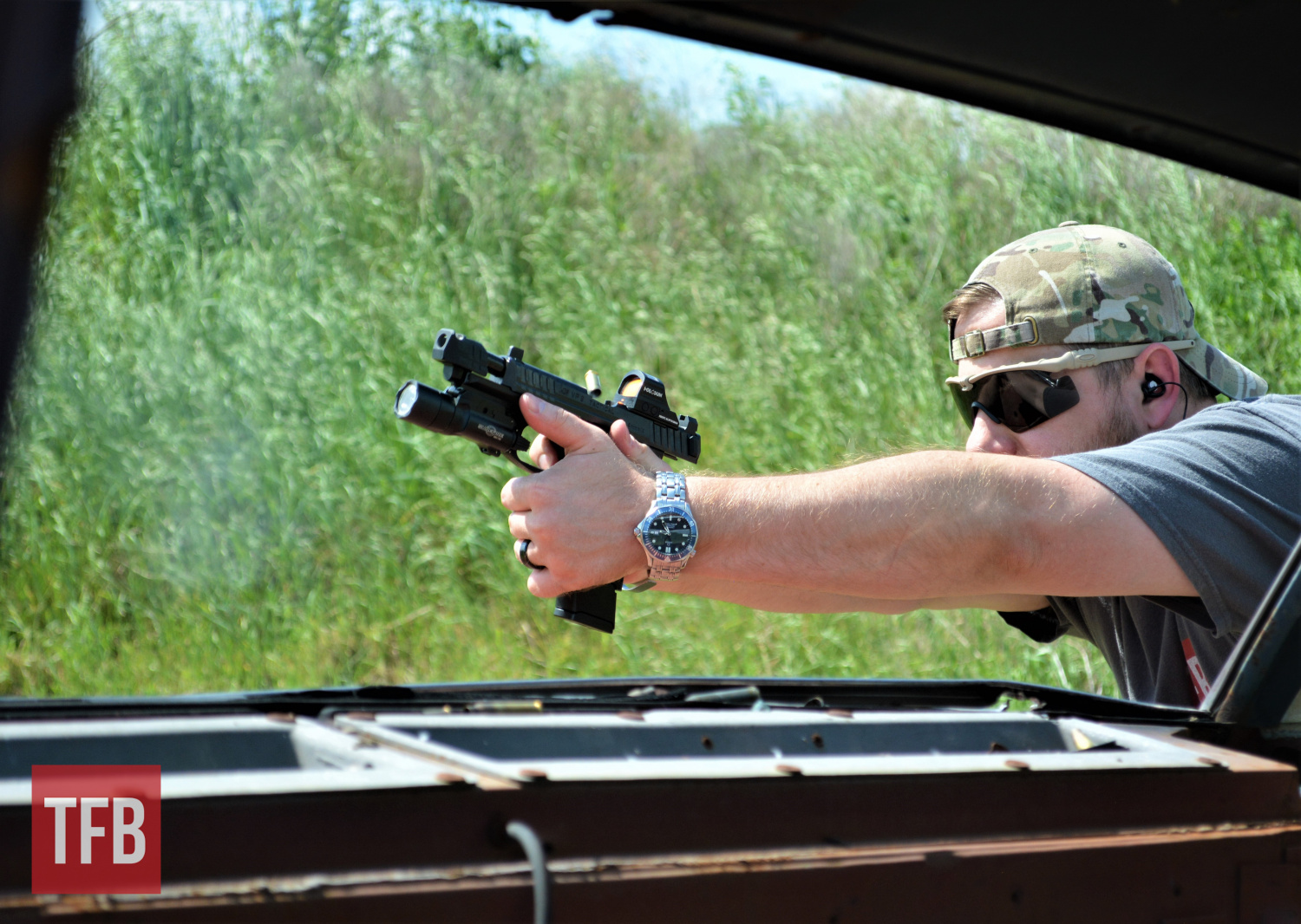 Obligatory action shot, with dissipating smoke/cycling slide/flying brass. The VP9 was thoroughly enjoyable to shoot!
