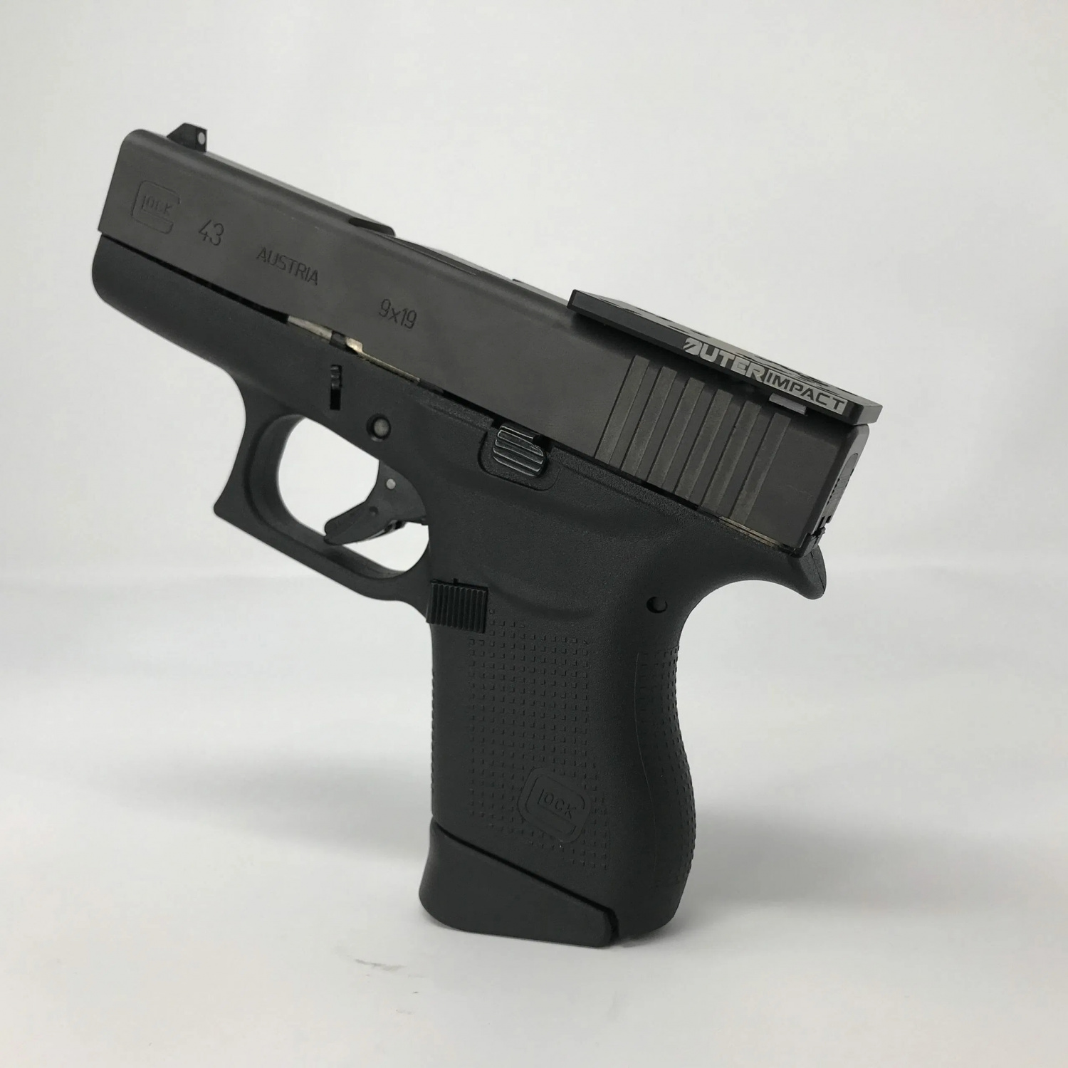 Until this merger, OuterImpact's flagship product has been their M.R.A., or Modular RedDot Adapter, shown here.