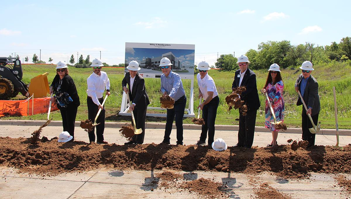 Representatives from the company digging in at the ground-breaking ceremony.
