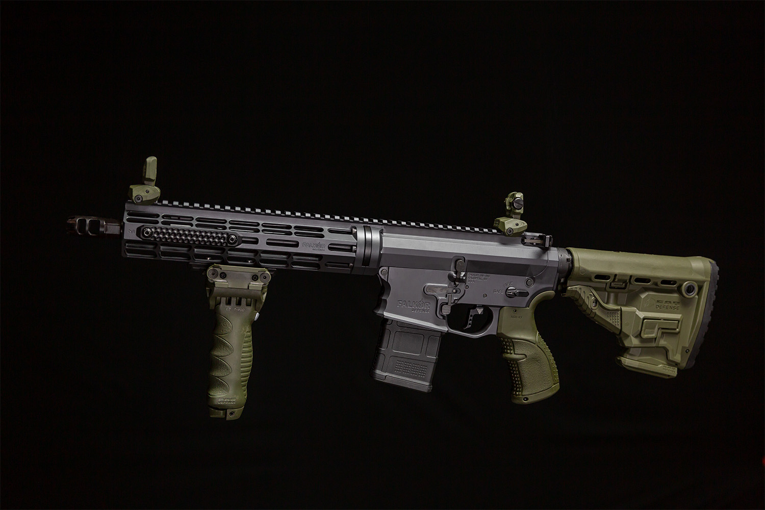 The GL Core-M stock in OD Green shown installed on a rifle, along with some of the company's other products.