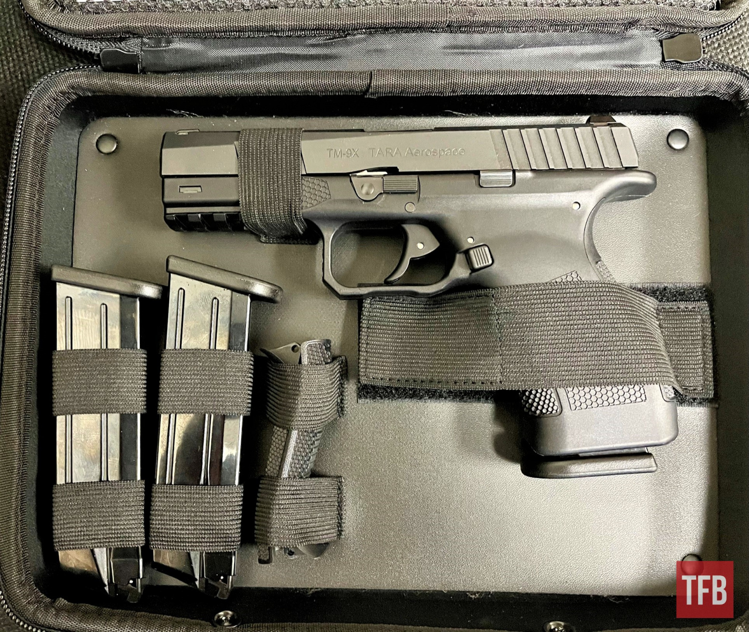 Unzipping the case revealed the TM-9, along with its three magazines and alternate backstrap sizing options.