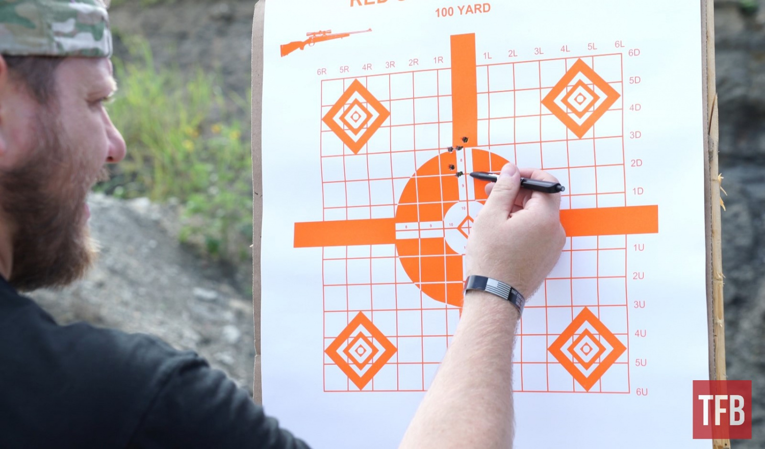 Examining and marking the first group I shot out of the Predator. After a few more rounds, we were able to get the gun's groups tightened down a bit and nicely on target.